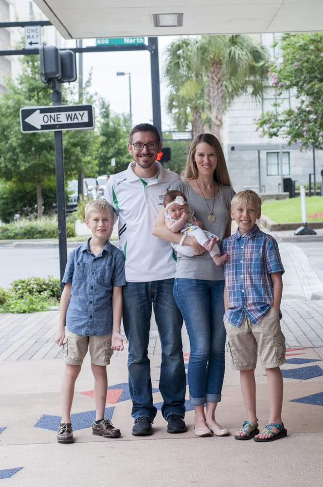 picture of a family in Tampa, Florida downtown with two boys and a baby girl