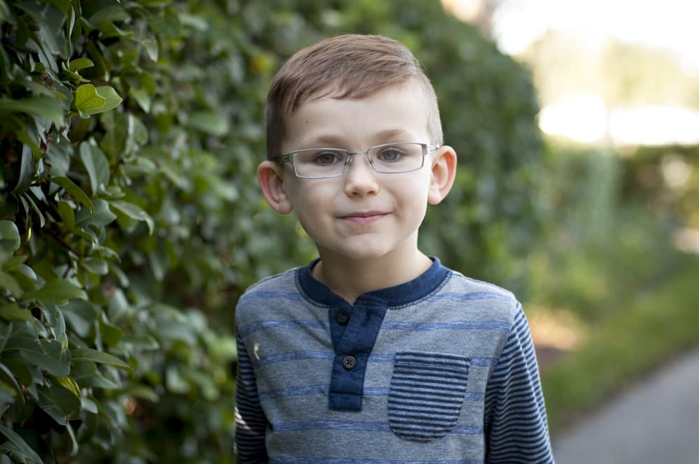 five year old boy in glasses