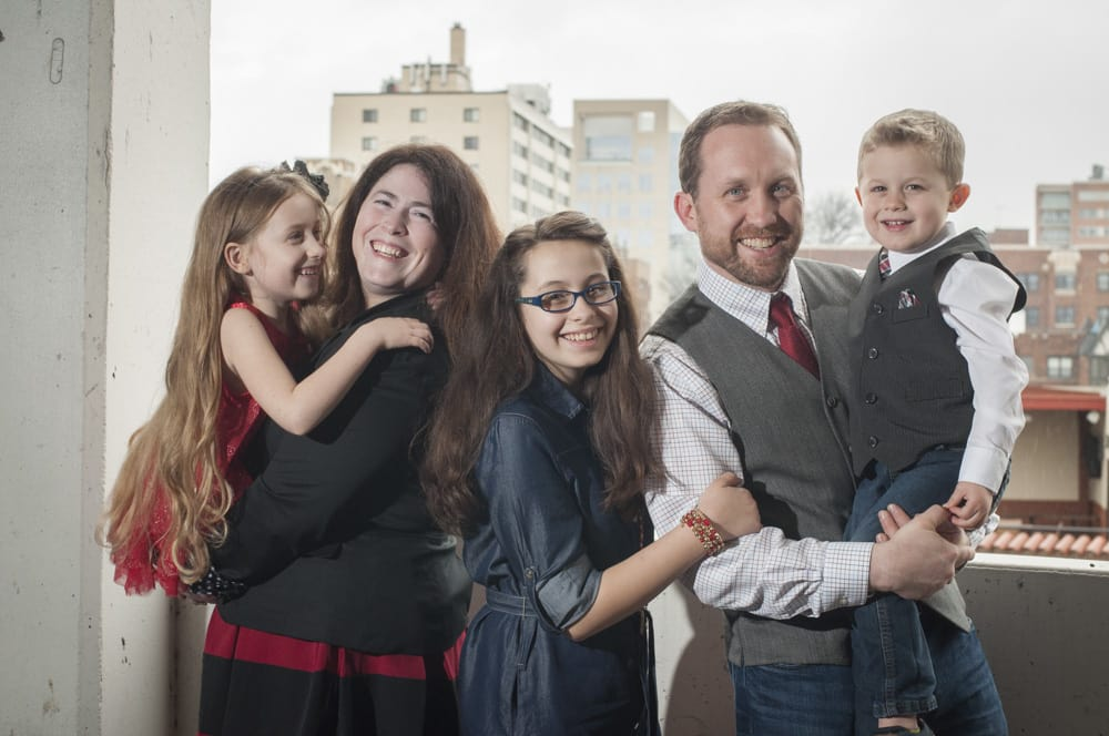 dressed up family with three children in a cityscape in Kansas City, Mo