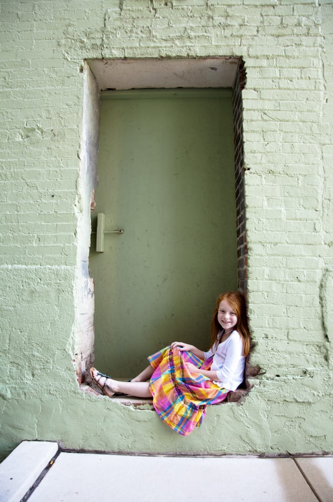 picture of young girl in urban doorway