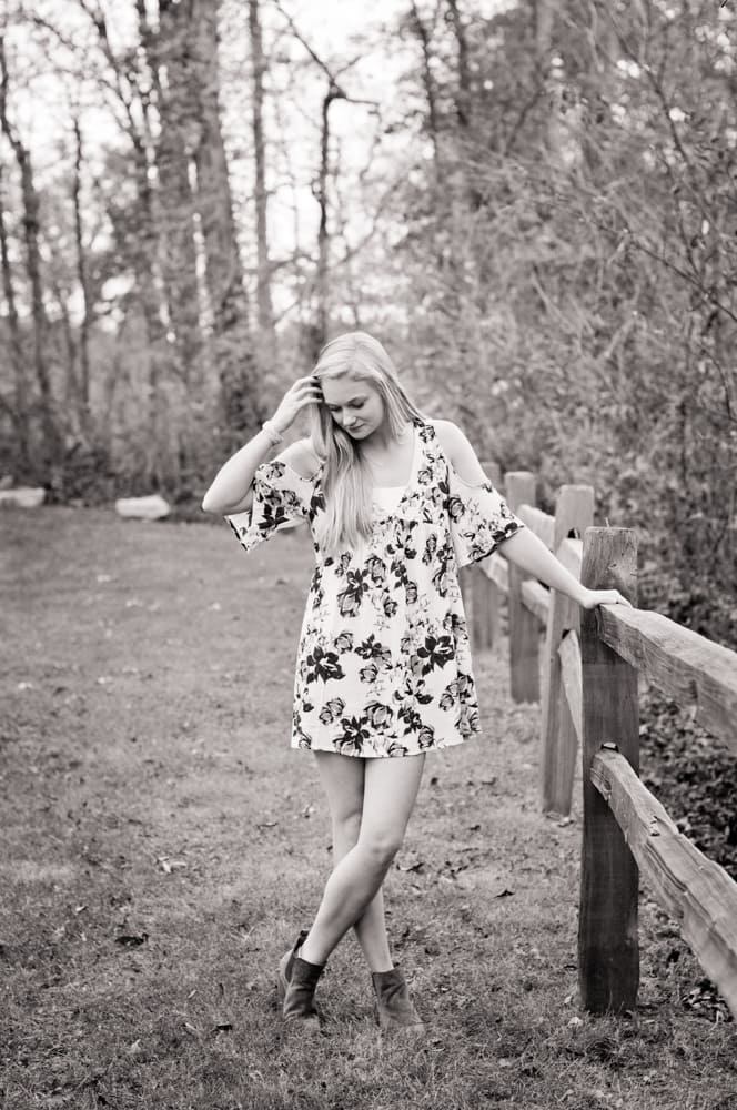 Outdoor senior young woman photographed in west county outside of saint louis, looking down