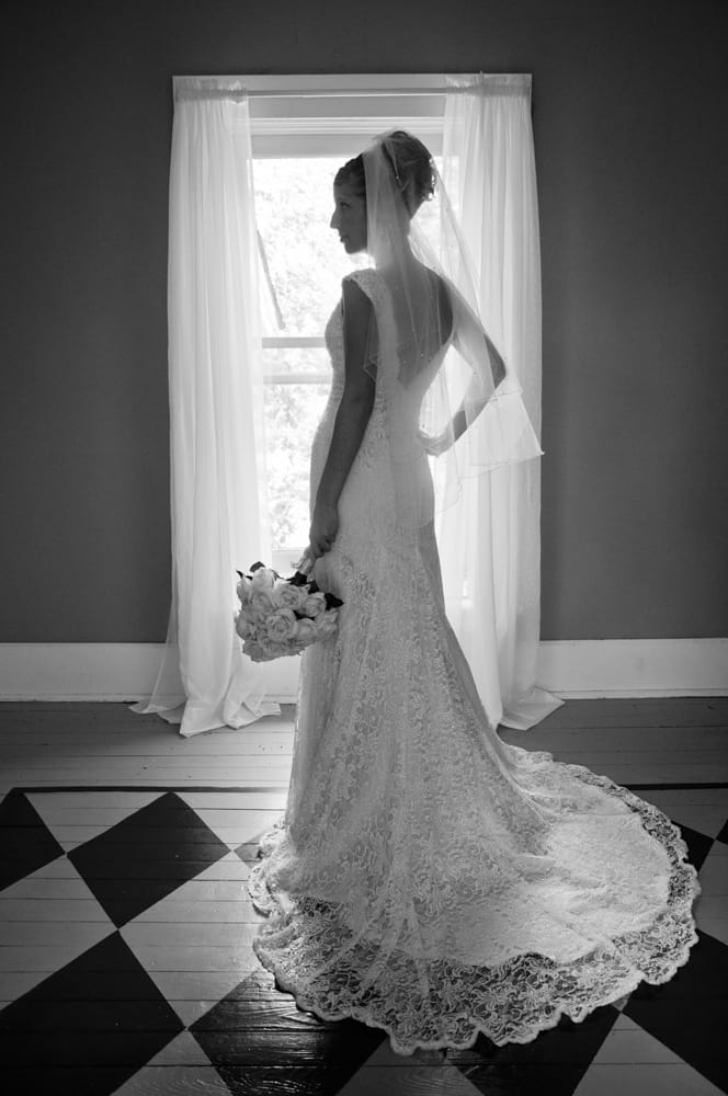 bride standing by window in Monticello IN