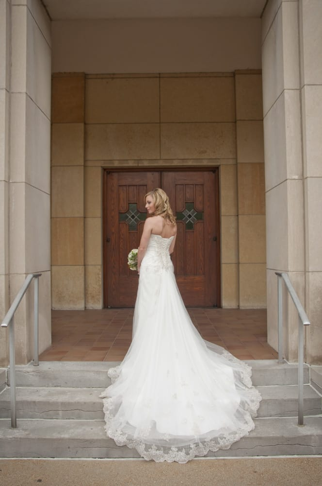 Bride on church steps in South City in St. Louis