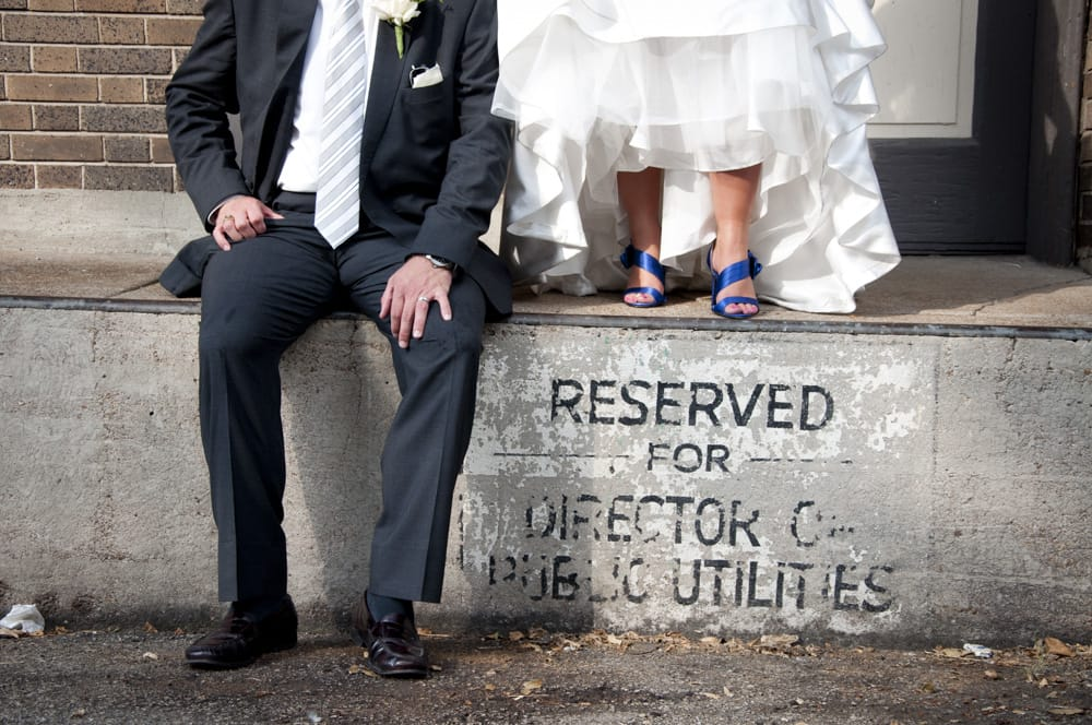 urban bride and goom with blue shoes