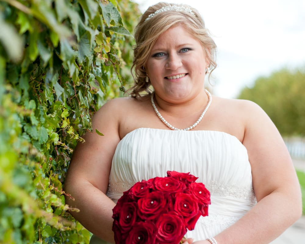 Bride with red flowers in New Town in St. Charles MO