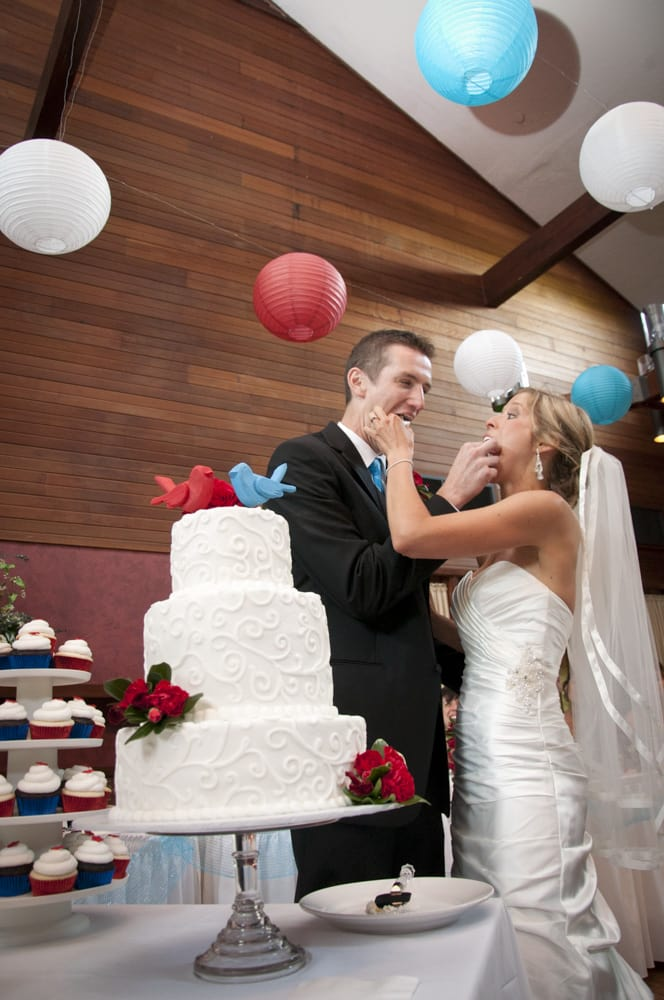 Innsbrook wedding reception cake cutting with red white and blue cardinal theme