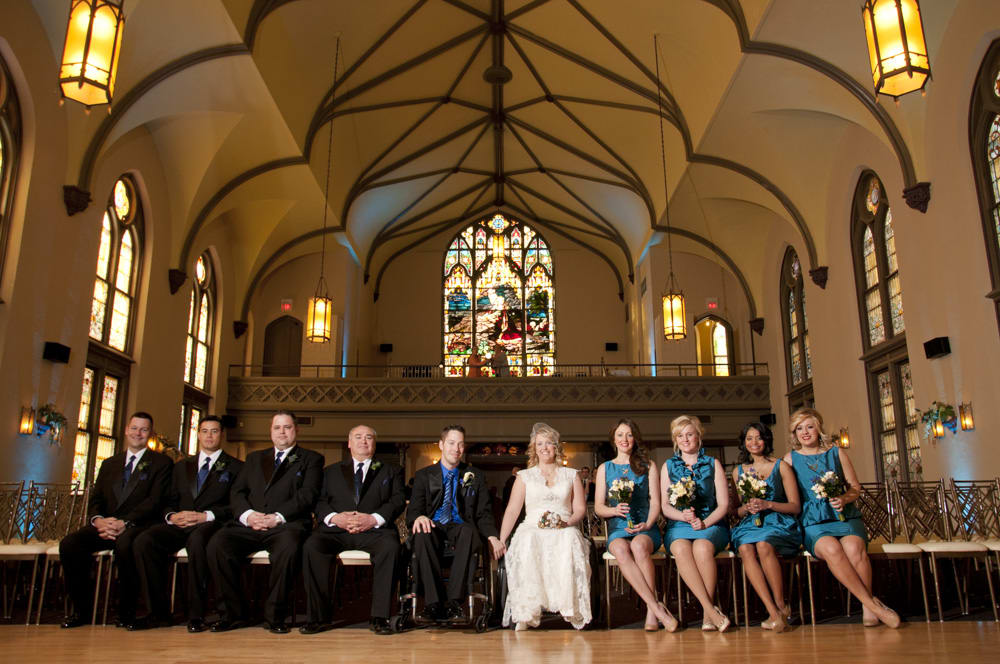 Wedding party seated pose in soulard wedding venue including wheelchair users and persons with a spinal cord injury or person with a disability