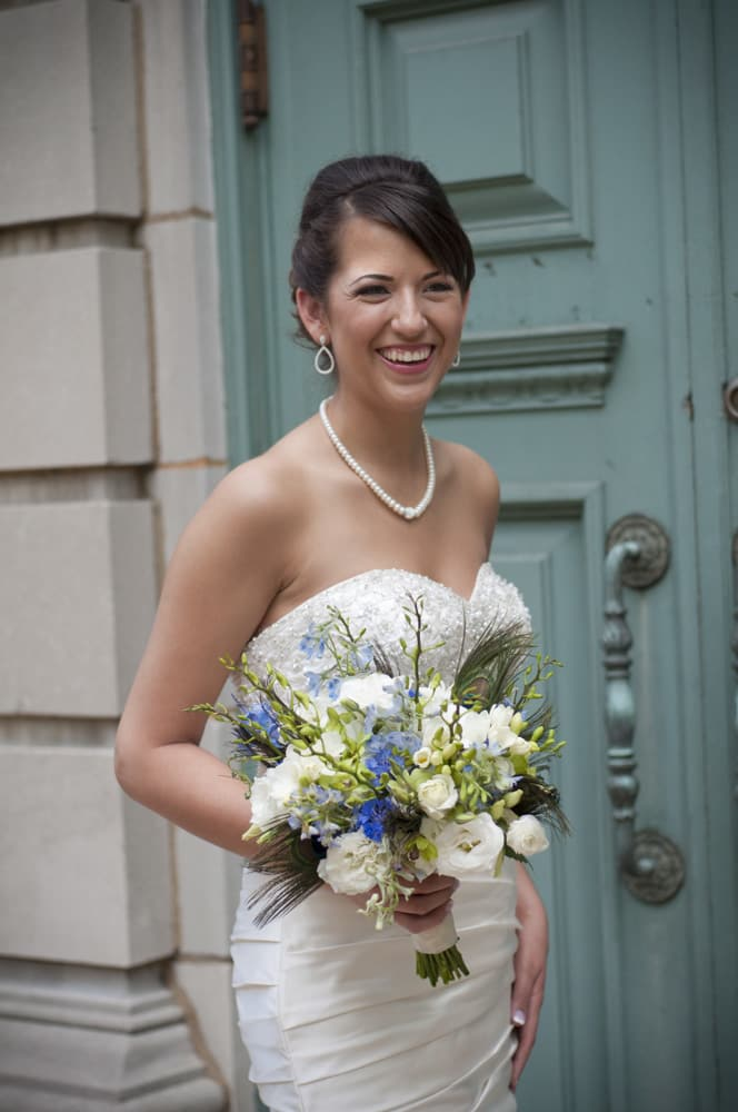bride smiling for portrait in University City with teal door