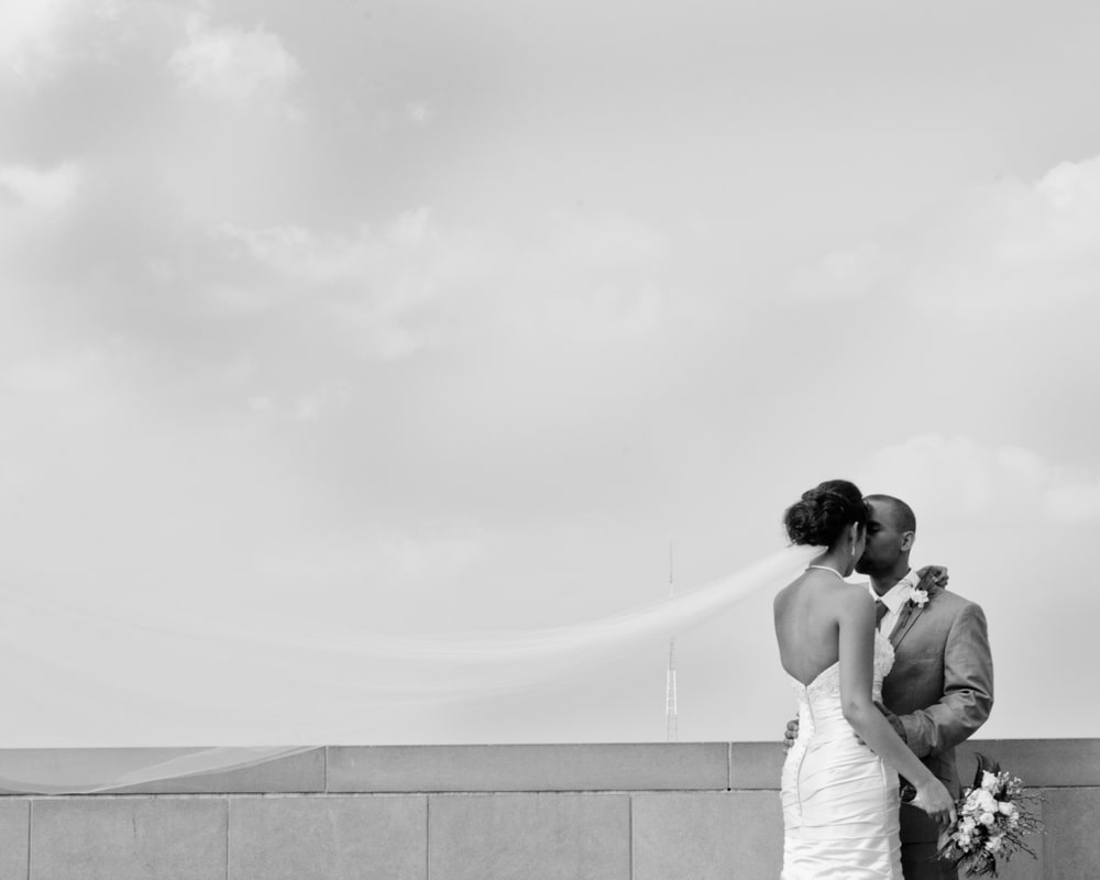 Couple with long veil in the wind at Forest Park in St. Louis MO