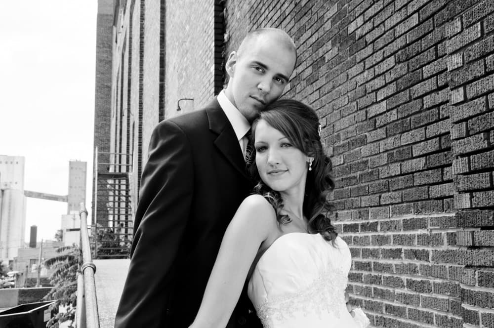 Couple posed in urban location in Alton, IL for wedding pictures