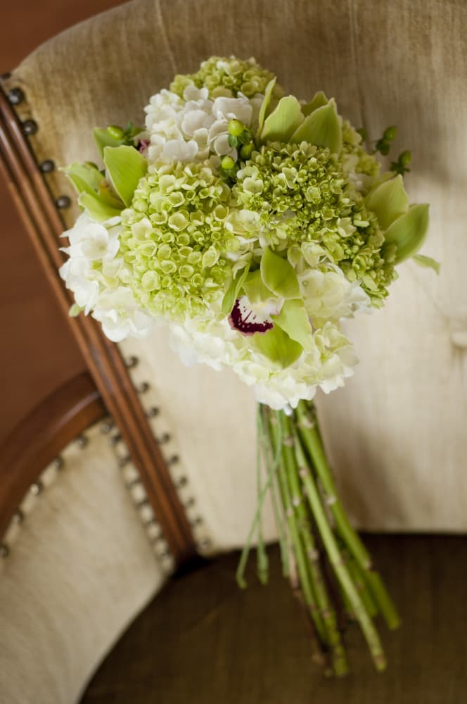 Bridal Bouquet with long stems on vintage chair in KCMO