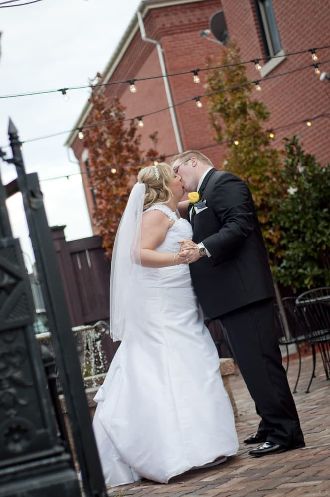 Couple kissing in courtyard at New Town on wedding day