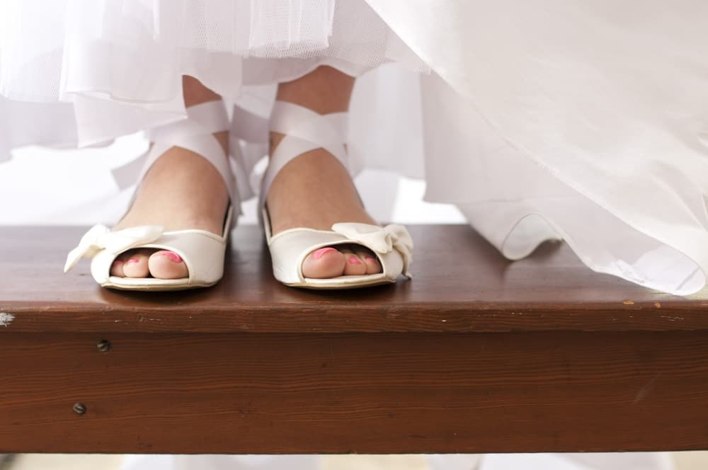 Brides flat shoes with ballet laces on wooden bench near Lindenwood University