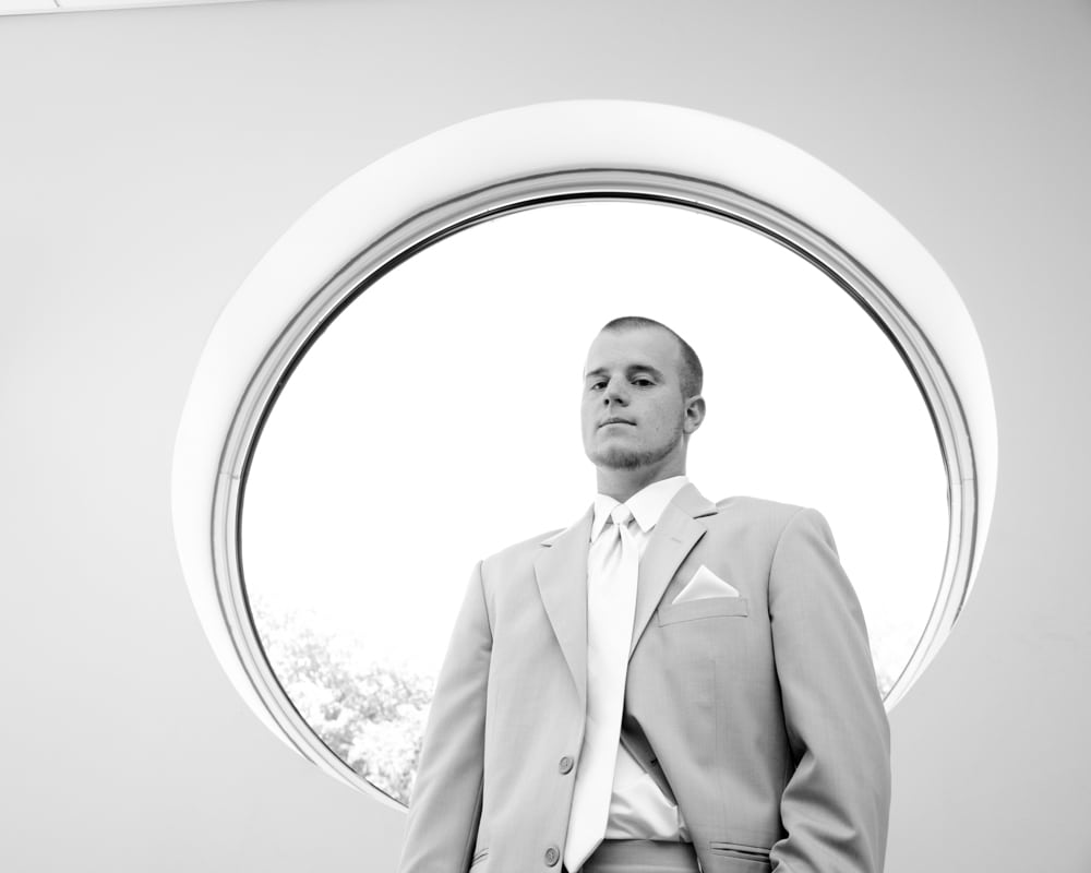 Groom in circle window in St. Charles MO