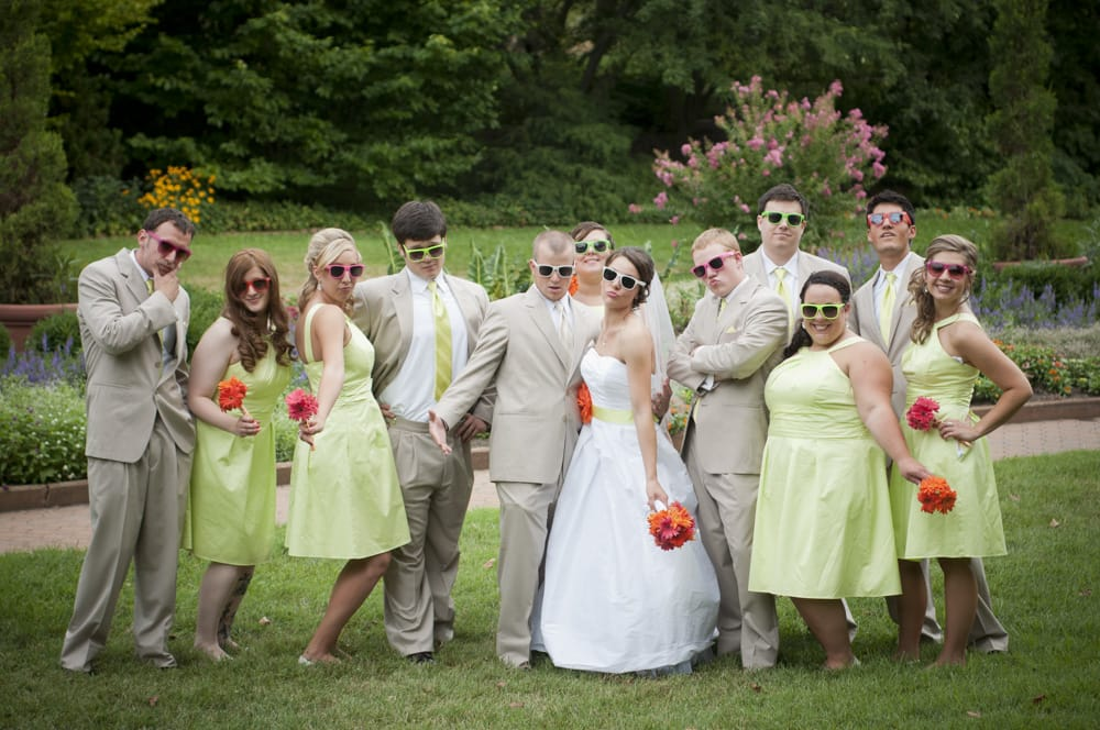 Fun, colorful bridal party having a good time with sunglasses and posing in St. Charles MO before reception