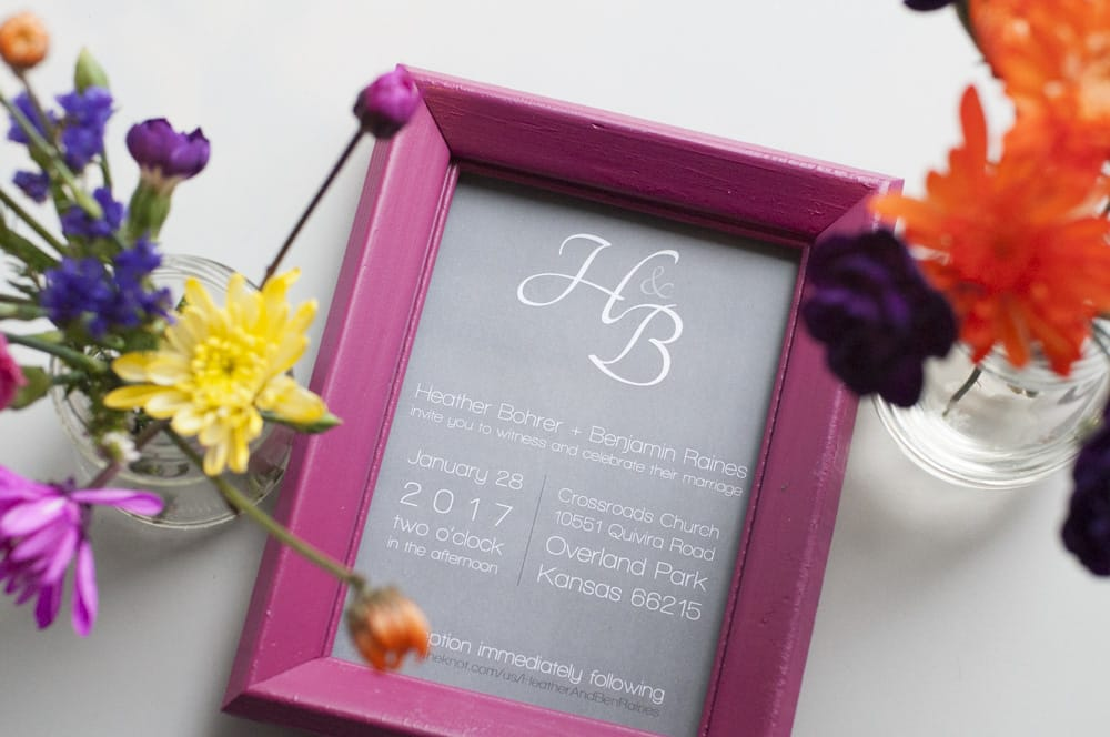 Flowers and framed wedding invitation created by photographer of wedding with graphic design in STL for destination wedding