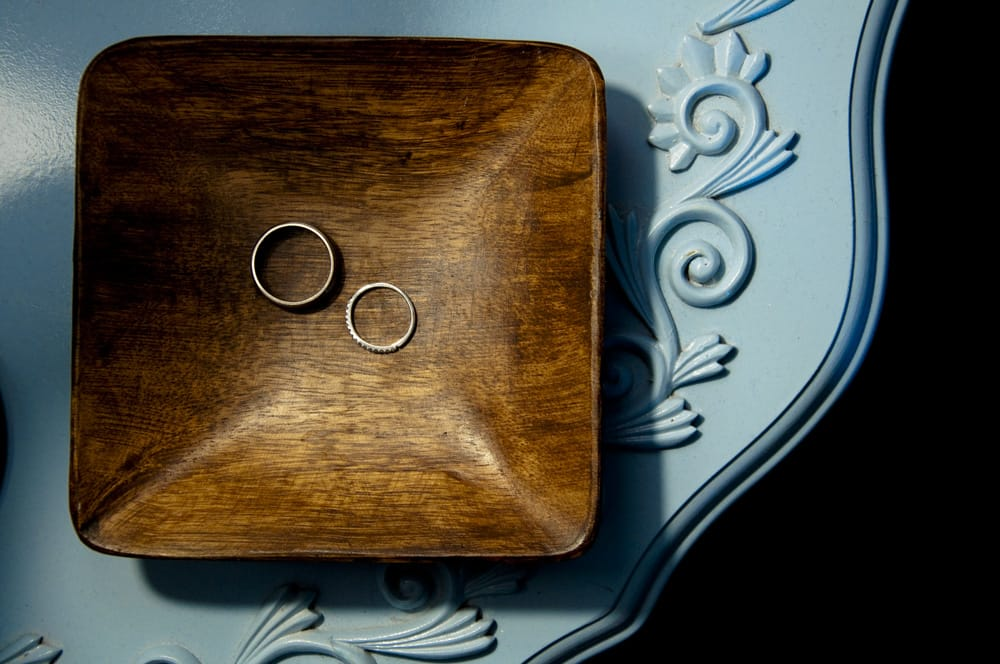 Wedding rings on wooden dish in St. Charles MO