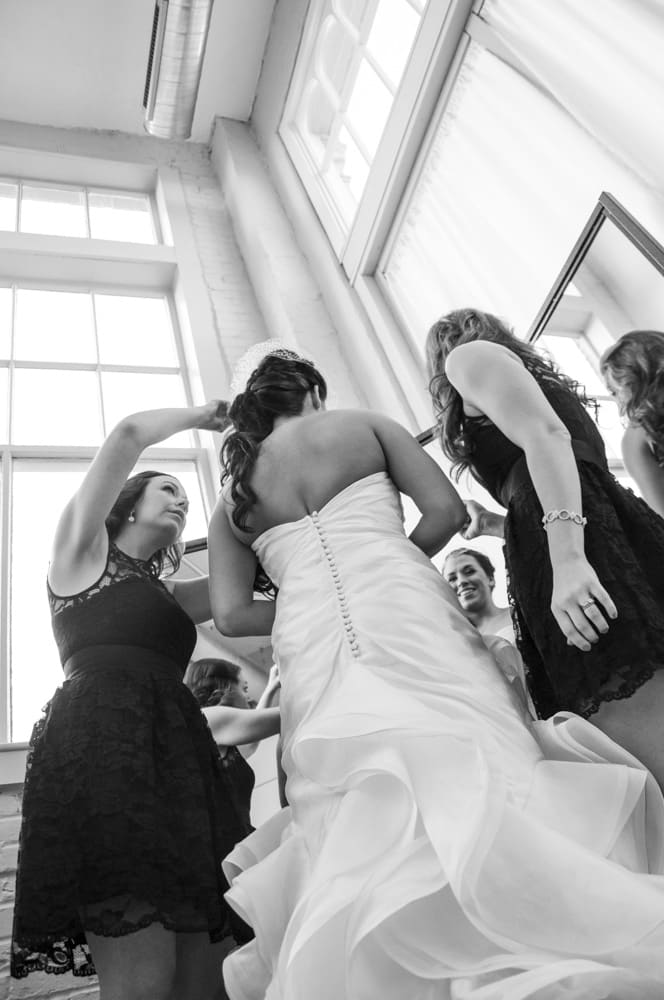 bridesmaids helping bride get ready at NEO on Locust