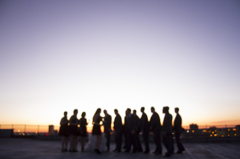 rooftop weddng picture with blurry sunset in St. Louis MO