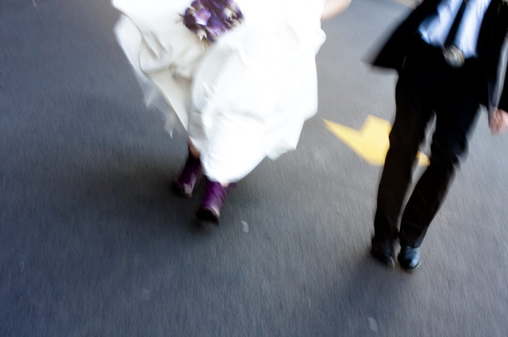 wedding couple on the move with arrow, belt buckle, cowboy boots, and purple details