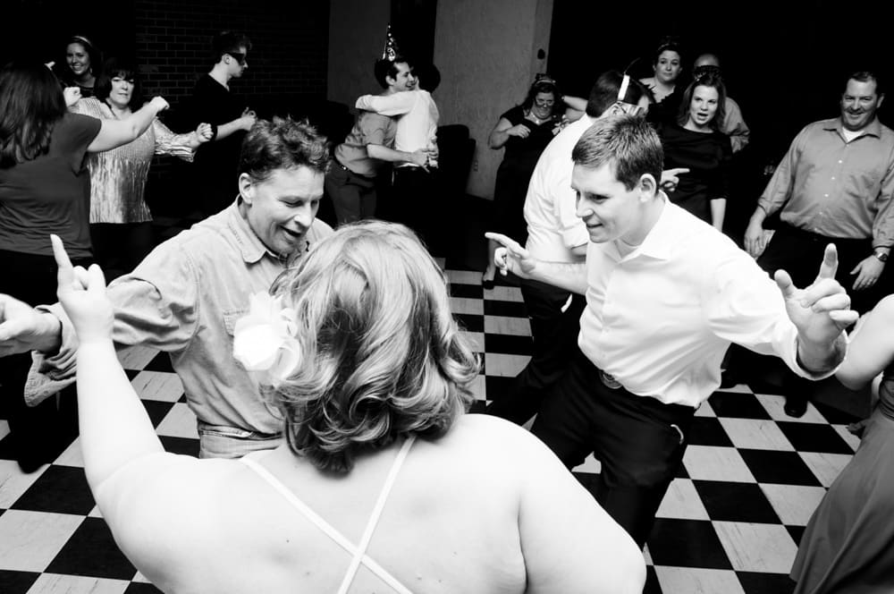 New Years Eve wedding reception party dancing with black and white checkered floor