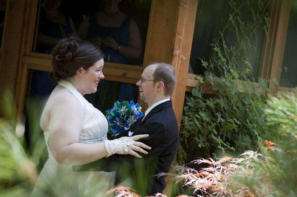 Couple has first look on wedding day in parent's garden at their home in Maplewood MO