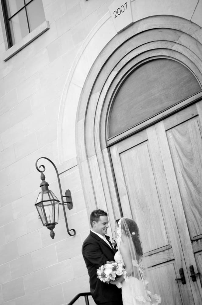 Bride and Groom look at each other on the chapel steps in New Town MO
