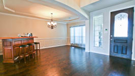 Beautiful Custom Built Home In Rockwall, Tx - Enter To Foyer With Rich Dark Hardwoods.