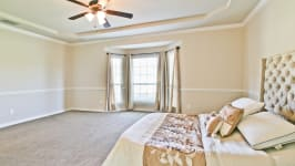 Beautiful Custom Built Home In Rockwall, Tx - Master Bedroom With Seating Nook And Walk In Closet.