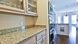 Beautiful Custom Built Home In Rockwall, Tx - Butlers Pantry With A Full Walk In Pantry Between The Kitchen And Dining Room.