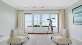 Serenity On The Sound - Sitting Room With Sliding Glass Doors To The Covered Balcony.
