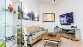 10225 Collins Ave #402
