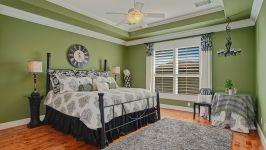 11507 Bistro Lane, Royal Oaks Country Club - Relax Into A Cozy Haven In This Beautiful Bedroom With Ensuite Bath And Walk In Closet. A Soothing Color Scheme Is Combined With Comfortable Amenities, Perfect For Sleeping And Lounging.