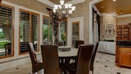 11507 Bistro Lane, Royal Oaks Country Club - A Luxurious Niche Just Off The Kitchen Reveals A Window Wrapped Breakfast Room, Washed In Golden Hues Of Sunlight That Becomes A Perfect Warren For Casual Family Meals.