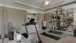 11507 Bistro Lane, Royal Oaks Country Club - This Amazing Home Includes A Superb List Of Amenities Including A Private Exercise Room Fitted With Two Mirrored Walls, Reinforced Ceiling For Equipment, Refreshing Ceiling Fan And Walk In Closet.