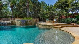 11507 Bistro Lane, Royal Oaks Country Club - Kick Back And Enjoy All The Pleasures On The Oversized Alfresco Patio. Here You Can Enjoy The Splendor Of The Custom Fire Pit Nestled Alongside The Soothing Sounds Of The Waterfall Pool.