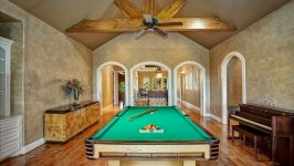 11507 Bistro Lane, Royal Oaks Country Club - Every Room Is Marked By Uncompromising Attention To Detail And Scale, With A Stunning Beam Vaulted Game Room Embraced  By Plantation Shutters, With Exquisite Built Ins And Covered Slate Patio Capturing Vistas Over The Resort Inspired Backyard.