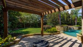 11507 Bistro Lane, Royal Oaks Country Club - This Alfresco Oasis Extends Its Generous Dimensions To A Pergola Shaded Patio That Simply Sparkles With Lush Beauty And Gracious Livability.