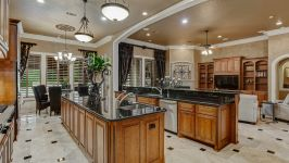 11507 Bistro Lane, Royal Oaks Country Club - Gleaming Granite Counters, Oversized Island, Breakfast Bar With Corbel Detail, Prep Sink And Custom Cabinetry With Undercount Lighting All Rise To The Occasion In The Kitchen.