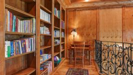 11507 Bistro Lane, Royal Oaks Country Club - Rows Of Built In Bookshelves Line The Walls Of The Second Floor Library With Balcony Overlooking The Office Below.
