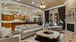 11507 Bistro Lane, Royal Oaks Country Club - The Wonder Of The Living Room Concludes With Built In Speakers, Travertine Floors And Handsome Built In Cabinetry.