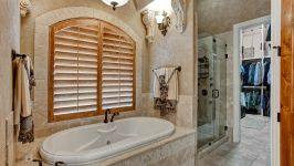 11507 Bistro Lane, Royal Oaks Country Club - A Relaxing Jetted Soaking Tub And Spa Inspired Walk In Shower As Well As His & Hers Sinks With Seated Vanity Maintain A Lavish Air Of Serenity.