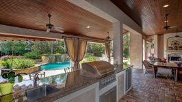 11507 Bistro Lane, Royal Oaks Country Club - The Summer Kitchen Is Expertly Fitted With A Built In Grill, Sink, Fridge And Bar Seating In Direct Overlook Of The Pool.