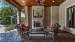 11507 Bistro Lane, Royal Oaks Country Club - Wrapped Around The Prestige Of An Enchanting Cast Stone Fireplace, The Covered Alfresco Lounge Is Pure Magic For Savoring The Views.