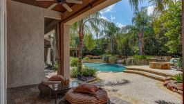 11507 Bistro Lane, Royal Oaks Country Club - A Series Of Delightful Paver Patios Outside The Master Suite Cast Their Gaze Out Over The Mesmerizing Beauty Of The Custom Heated Lagoon Pool And Its Tranquil Water Features.
