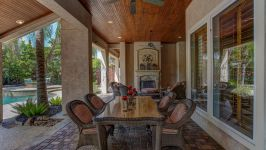 11507 Bistro Lane, Royal Oaks Country Club - Enjoying A Quiet Alfresco Meal Is A Breeze In The Shaded Respite Of The Covered Patio.