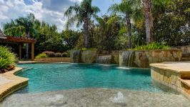 11507 Bistro Lane, Royal Oaks Country Club - This Beautiful Custom Heated Lagoon Pool Is Sensational With Several Shallow Tanning Shelves Surrounded By Melodic Waterfalls And Fountains.