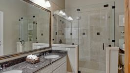 11507 Bistro Lane, Royal Oaks Country Club - A Granite Vanity With Double Sinks In This Main Floor Bath Streamlines A Daily Routine Accompanied By A Beautifully Tiled Walk In Shower With Built In Bench.
