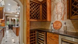 11507 Bistro Lane, Royal Oaks Country Club - If You Enjoy Savoring The Experience Of A Fine Wine, Then The Wine Grotto Is A Dream Destination Outfitted With Two Wine Chillers And An Artful Display Of Custom Faux Paint.