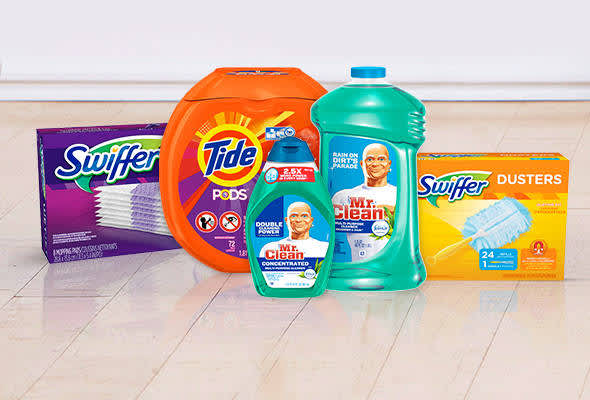 Swiffer, Tide, and Mr Clean products on an otherwise empty floor in front of a white backdrop